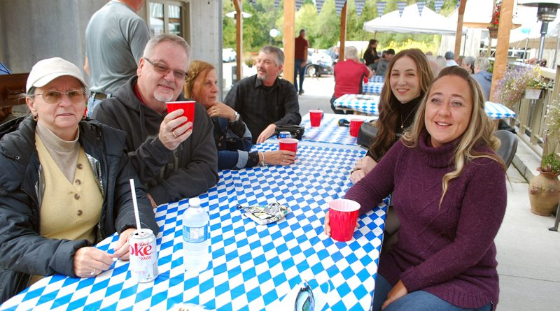 A group of friends gathered to enjoy the music, the food and the beer at the Oktoberfest festivities on Saturday. Pictured from front left are Ginette Savoie, Jacques Boissonneault, Thelma Morin and Charles Morin. At right, from front to back are Nathalie Savoie, Adèle Boisvert and Raymond Morin.