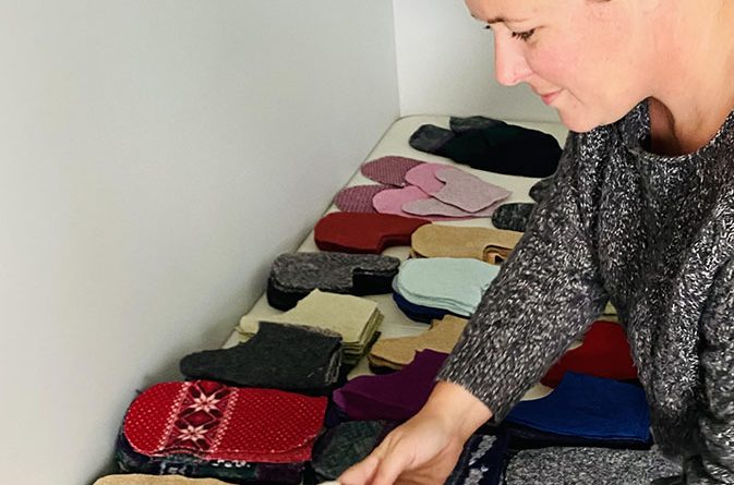 Ashley Hodgins setting her assembly line of cut pieces of wool and fleece in order to get the product ready for sewing.